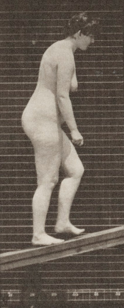 Nude woman ascending an incline