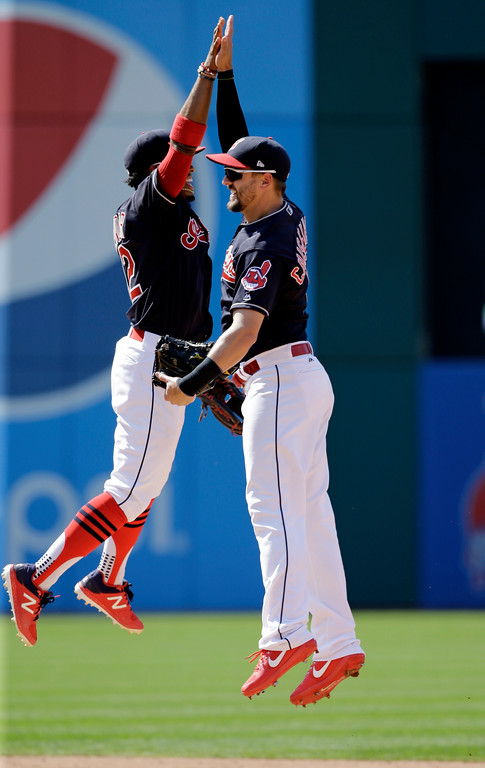 . Cleveland Indians\' Lonnie Chisenhall, right, celebrates with Francisco Lindor after they defeated the Chicago White Sox in a baseball game, Sunday, June 11, 2017, in Cleveland. (AP Photo/Tony Dejak)
