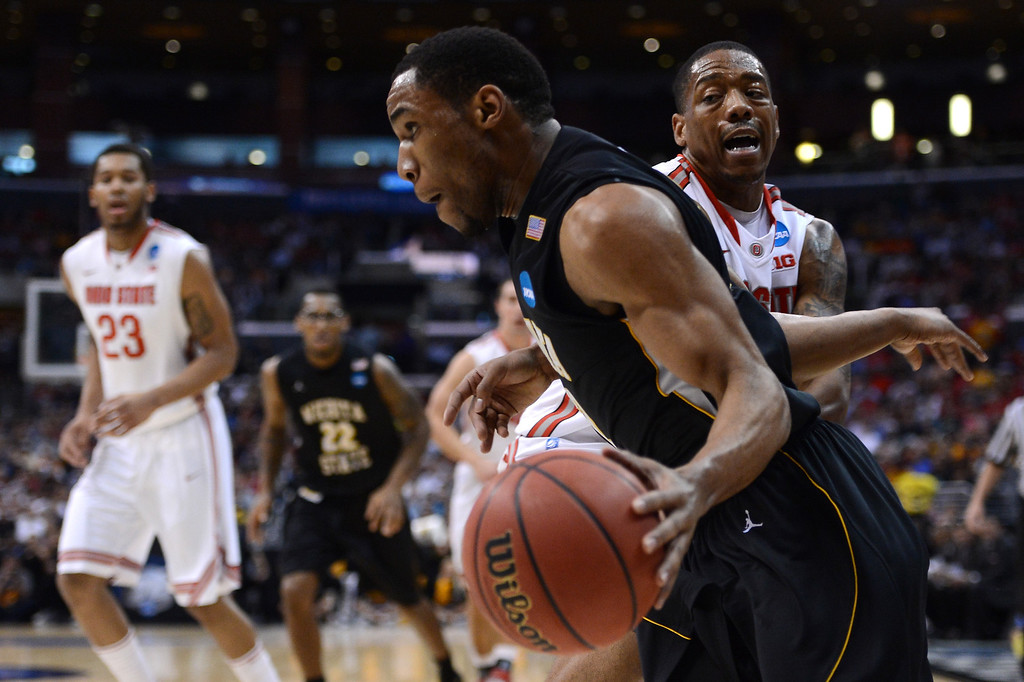 . LOS ANGELES, CA - MARCH 30:  Tekele Cotton #32 of the Wichita State Shockers drives on Lenzelle Smith, Jr. #32 of the Ohio State Buckeyes in the first half during the West Regional Final of the 2013 NCAA Men\'s Basketball Tournament at Staples Center on March 30, 2013 in Los Angeles, California.  (Photo by Harry How/Getty Images)