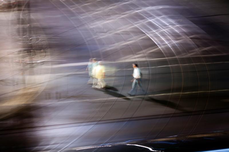 Panning shot of pedestrians crossing a road, Berlin, Germany