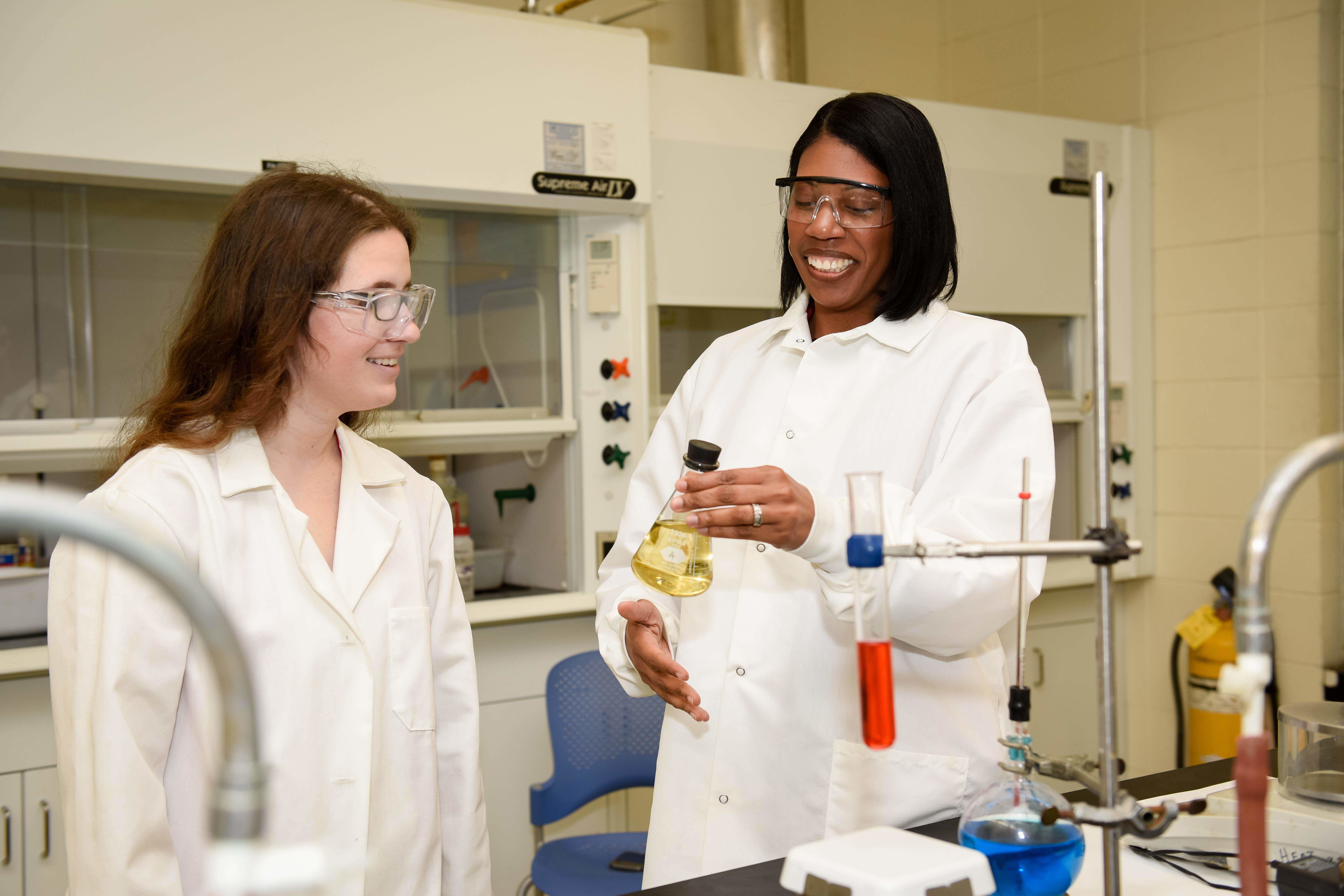 Dr. Mills, right, in chemistry lab with a student.