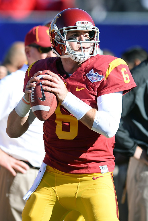 . LAS VEGAS, NV - DECEMBER 21:  Quarterback Cody Kessler #6 of the USC Trojans warms up before playing the Fresno State Bulldogs in the Royal Purple Las Vegas Bowl at Sam Boyd Stadium on December 21, 2013 in Las Vegas, Nevada. USC won 45-20.  (Photo by Ethan Miller/Getty Images)