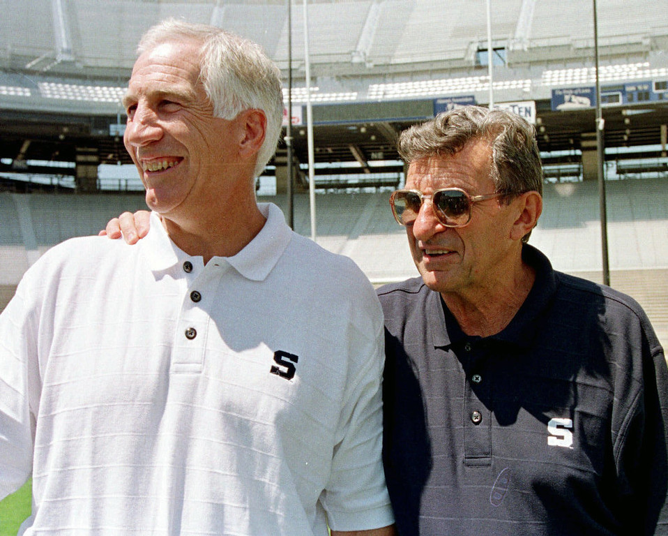 ". In this Aug. 6, 1999, file photo, Penn State football coach Joe Paterno, right, poses with his defensive coordinator. Jerry Sandusky, during the college football team\'s media day in State College, Pa. Former FBI director Louis Freeh, who led a Penn State-funded investigation into the university\'s handling of molestation allegations against former assistant football coach Jerry Sandusky, is scheduled to release his highly anticipated report Thursday, July 12, 2012. ""Penn State Scandal\"" ranked as Google\'s eighth most searched trending event of 2012. (AP Photo/Paul Vathis, File)"