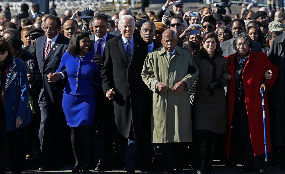 . Vice President Joe Biden, center, leads a group across the Edmund Pettus Bridge in Selma, Ala., Sunday, March 3, 2013. They were commemorating the 48th anniversary of Bloody Sunday, when police officers beat marchers when they crossed the bridge on a march from Selma to Montgomery. From left: Selma Mayor George Evans, U.S. Rep. Terri Sewell, D-Ala., Rev. Jesse Jackson, Biden, Rev. Al Sharpton and U.S. Rep. John Lewis, D-Ga. (AP Photo/Dave Martin)