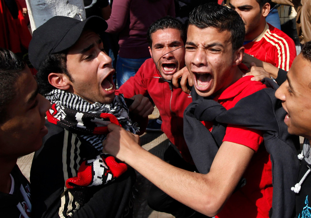 """. Al-Ahly fans, also known as \""""Ultras\"""", celebrate and shout slogans in front of the Al-Ahly club after hearing the final verdict of the 2012 Port Said massacre in Cairo March 9, 2013.  REUTERS/Amr Abdallah Dalsh"""