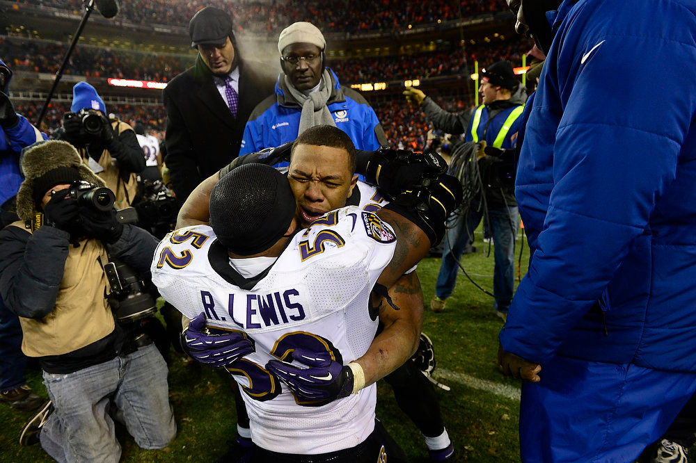 . Baltimore Ravens inside linebacker Ray Lewis (52) and Baltimore Ravens running back Ray Rice (27) hug at the end of overtime after the Ravens kicked a field goal to win. The Denver Broncos vs Baltimore Ravens AFC Divisional playoff game at Sports Authority Field Saturday January 12, 2013. (Photo by AAron  Ontiveroz,/The Denver Post)