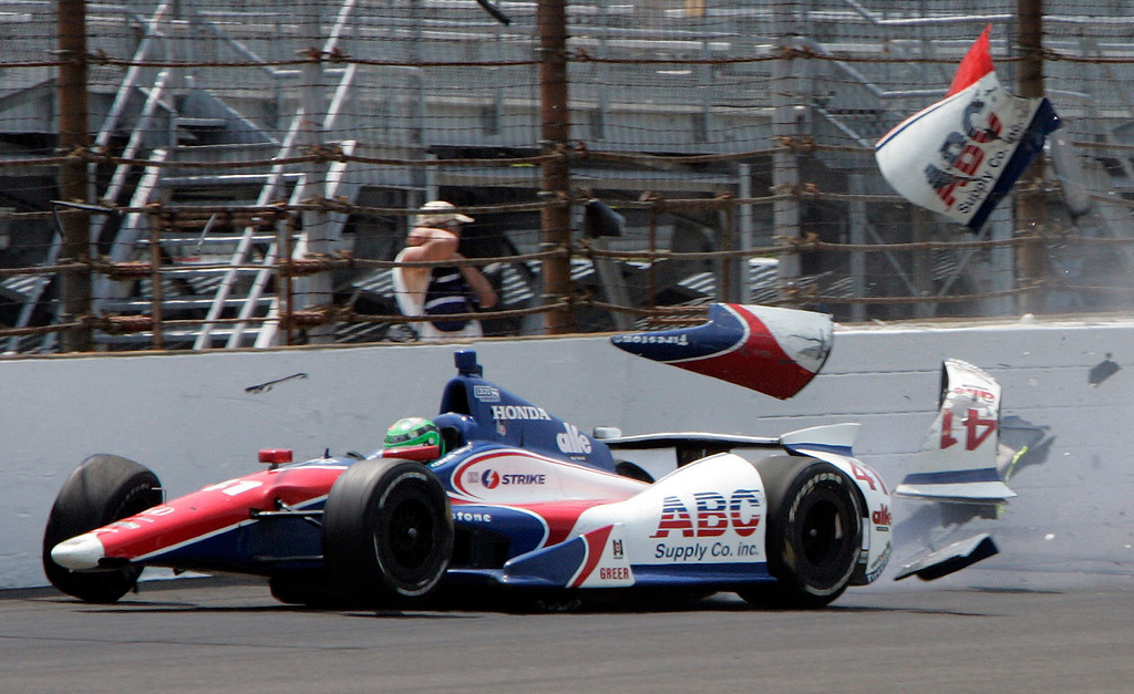 . The car driven by Conor Daly hits the wall in the first during practice for the Indianapolis 500 auto race at the Indianapolis Motor Speedway in Indianapolis, Thursday, May 16, 2013. Daly was not injured. (AP Photo/Joe Watts)