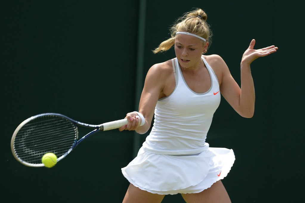 . Germany\'s Carina Witthoeft returns against Japan\'s Kimiko Date-Krumm during their women\'s first round match on day two of the 2013 Wimbledon Championships tennis tournament at the All England Club in Wimbledon, southwest London, on June 25, 2013. Date-Krumm won 6-0, 6-2.  ADRIAN DENNIS/AFP/Getty Images