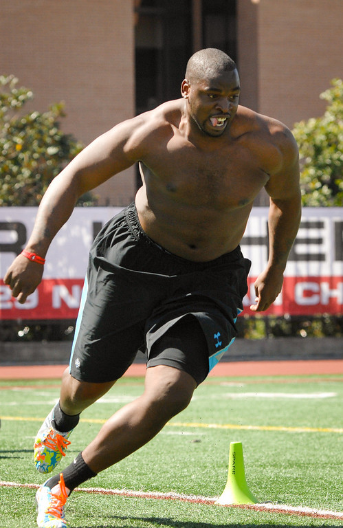 . George Uko runs a drill at USC Pro Day, Wednesday, March 12, 2014, at USC. (Photo by Michael Owen Baker/L.A. Daily News)