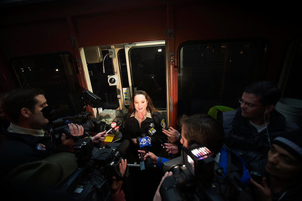 . Toll collector Marilyn Alvardo (C) speaks to members of the media from her tollbooth after receiving the last toll at the Golden Gate Bridge toll plaza in San Francisco, California March 27, 2013. The Golden Gate Bridge will convert from manned tollbooths to a full electronic tolling system starting today. With the automated system in place, motorists will have the option of using the existing FasTrak electronic toll collection system or the newly implemented pay-by-plate option, according to the Golden Gate Bridge management.  REUTERS/Stephen Lam