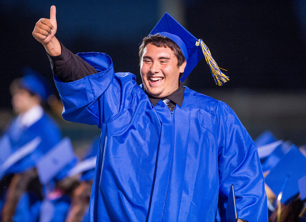 . Matthew Avila gives the thumbs up after receiving his diploma during California High graduation at their Whittier campus stadium June 13, 2013.   (SGVN staff photo by Leo Jarzomb)