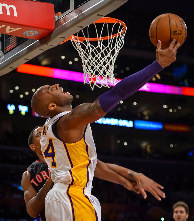 . Lakers� Kobe Bryant was fouled by Raptors� DeMar DeRozan during first half action at Staples Center Sunday, December 8, 2013.   ( Photo by David Crane/Los Angeles Daily News )