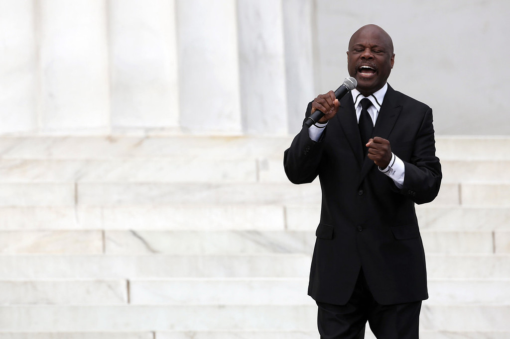 """. Seventh-day Adventist minister and vocal artist Rev. Wintley Phipps, Sr., sings during the Let Freedom Ring ceremony at the Lincoln Memorial August 28, 2013 in Washington, DC. The event was to commemorate the 50th anniversary of Dr. Martin Luther King Jr.\'s \""""I Have a Dream\"""" speech and the March on Washington for Jobs and Freedom.  (Photo by Alex Wong/Getty Images)"""