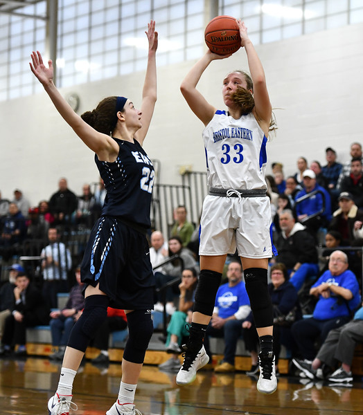 2/18/2020 Mike Orazzi | Staff Bristol Eastern's Jordan Ouellette (33) and East Catholic's Emily Jeamel (22) during a 57-52 Eastern overtime win in Bristol Tuesday afternoon.