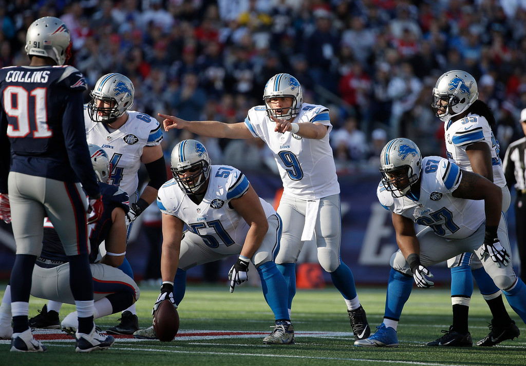 . Detroit Lions quarterback Matthew Stafford (9) calls signals at the line of scrimmage in the first half of an NFL football game against the New England Patriots Sunday, Nov. 23, 2014, in Foxborough, Mass. (AP Photo/Steven Senne)