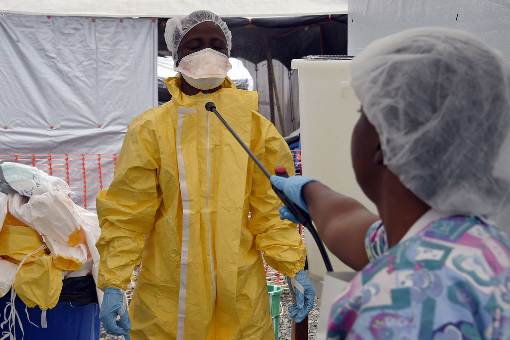 . A health worker is decontaminated at the medical centre of Doctor Without Borders (Medecin sans Frontiere (MSF) where people infected with the Ebola virus are treated in Monrovia on September 26, 2014. PASCAL GUYOT/AFP/Getty Images