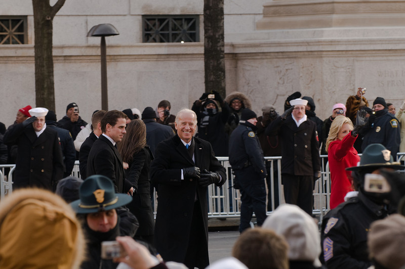 Vice President Joe Biden and his wife, Jill (in red coat) walking ahead of him.