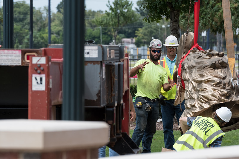 Christopher Cameron and Scott Butcher from D and T Steel talk about how to move the head of an 800 square-foot gamecock sculpture outside of Williams-Brice Stadium in center of the Lloyd Family Courtyard, on Sept. 10, 2020. John A. Carlos II / Special to The Post and Courier