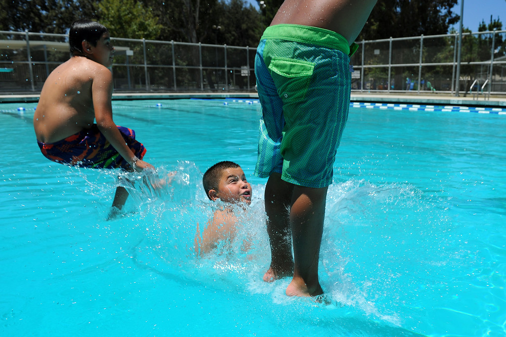 . Children leap into the pool at Lanark Park in Canoga Park, Saturday, June 14, 2014. (Photo by Michael Owen Baker/Los Angeles Daily News)