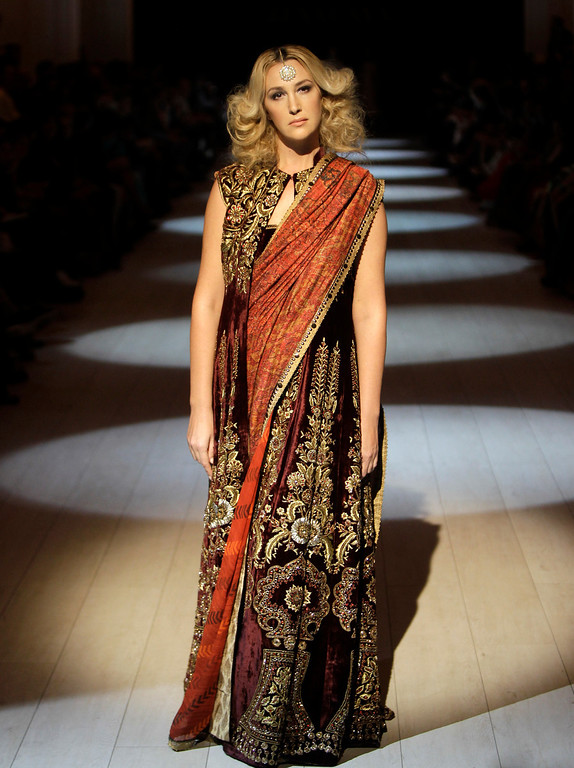 . A model displays outfits by Indian fashion designer JJ VALAYA, during a Fashion Week in Kiev, Ukraine, Sunday, Oct. 13, 2013. (AP Photo/Sergei Chuzavkov)