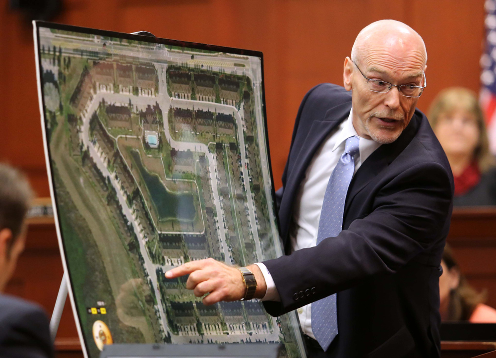 . Don West, a defense attorney for George Zimmerman, addresses the jury as he points to a map during opening statements in Seminole circuit court,  in Sanford, Fla., Monday, June 24, 2013.  Zimmerman has been charged with second-degree murder for the 2012 shooting death of Trayvon Martin. (AP Photo/Orlando Sentinel, Joe Burbank, Pool)