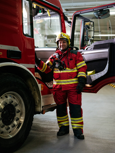 Alex Paonna, direct response crew (professional firefighters) in next to a Proteus truck, in the firefighter hangar on the French side - Samuel Zeller for the New York Times