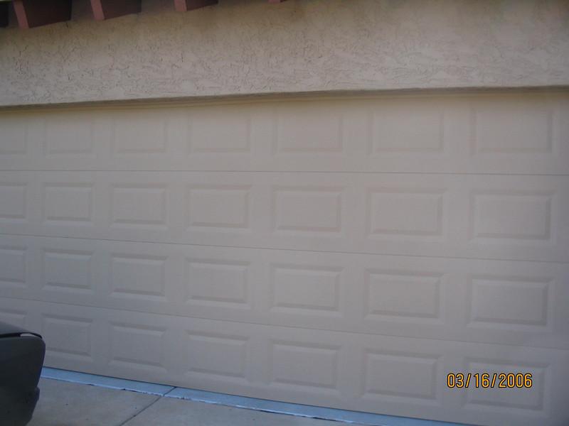 The newly-painted garage door.