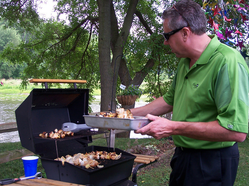 Mike & Linda Graf did a great job grilling brats and chicken kabobs