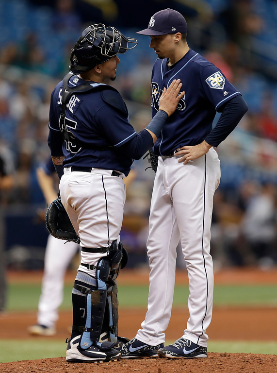 . Tampa Bay Rays catcher Jesus Sucre, left, talks to starting pitcher Blake Snell after Snell have up a home run to Cleveland Indians\' Jose Ramirez during the seventh inning of a baseball game Wednesday, Sept. 12, 2018, in St. Petersburg, Fla. (AP Photo/Chris O\'Meara)