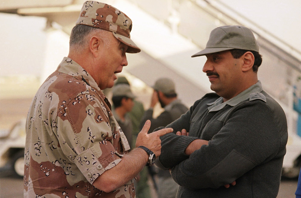 Description of . Gen. Norman Schwarzkopf, commander of U.S. forces in the Gulf, left, confers with Saudi Arabian Lt. Gen. Khalid Bin Sultan, commander of multinational forces in the area on Dec. 19, 1990 in Riyadh. The generals were awaiting the arrival on Wednesday of Defense Sec. Dick Cheney in Riyadh. (AP Photo/Peter Dejong)