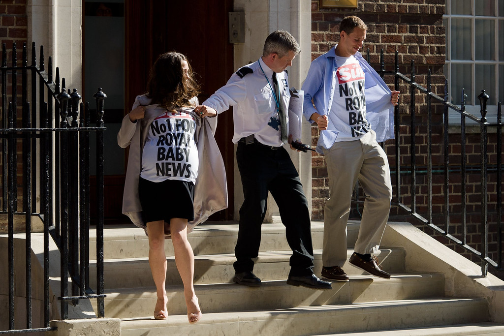 . Look-alikes of Catherine, Duchess of Cambridge and William, Duke of Cambridge are removed from the steps of the Lindo Wing of St Mary\'s Hospital in London, on July 19, 2013, where Prince William and his wife Catherine\'s baby is expected to be born. The long wait for the birth of Britain\'s royal baby is record business for bookmakers, as punters worldwide bet on a girl called Alexandra to be born any day now.  LEON NEAL/AFP/Getty Images