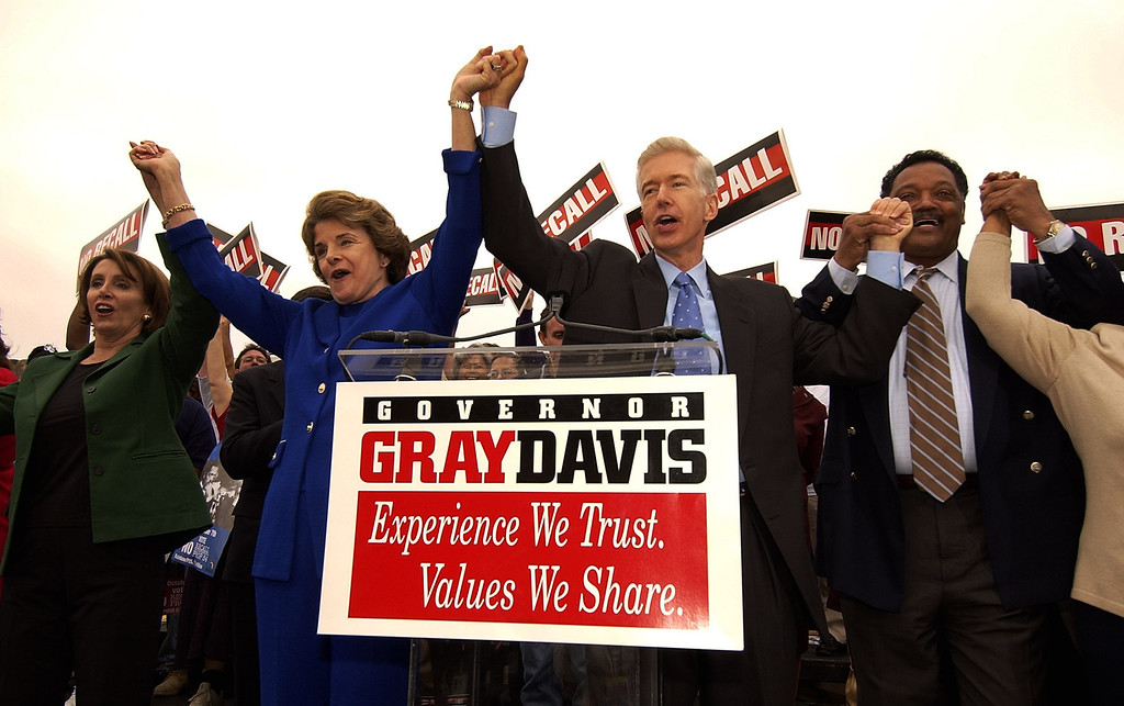 ". Nancy Pelosi (D-Ca), House Minority Leader, left, Sen. Diane Feinstein, second left, and Rev. Jesse Jackson, right, join California Gov. Gray Davis after attending a labor rally at Teamster\'s Hall in Oakland, Calif., Saturday, Oct. 4, 2003, to kick-off a three day ""Just Say No!\"" fly-around. (AP Photo/Kevork Djansezian)"