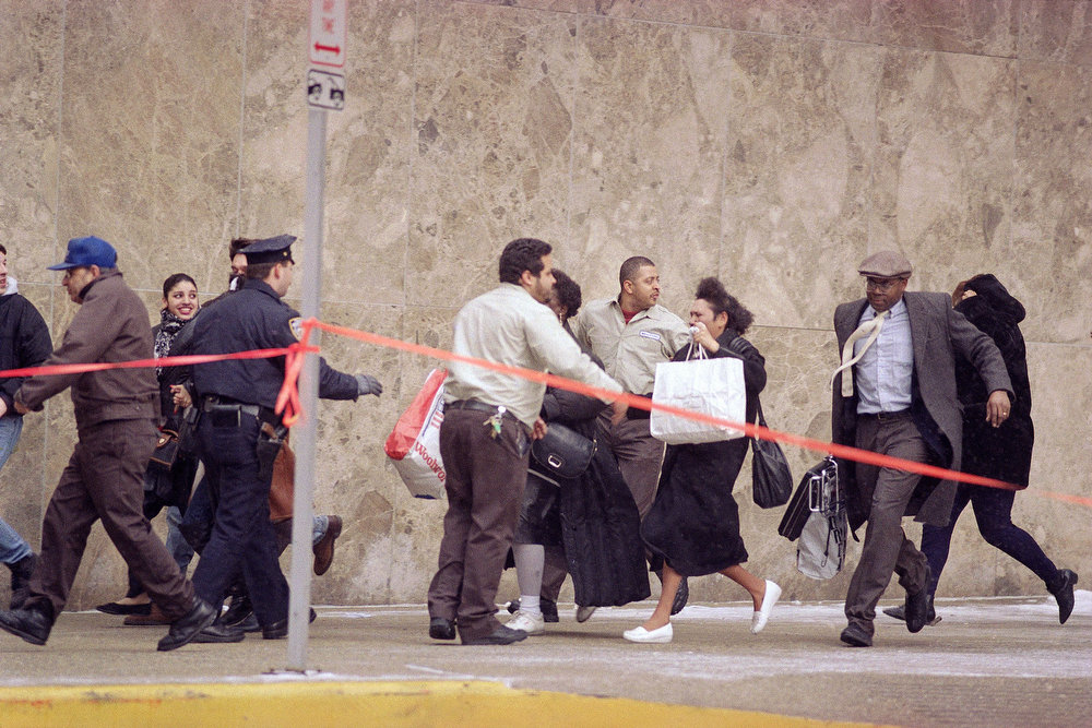 Description of . Passersby and workers rush from the World Trade Center in New York on Feb. 26, 1993 after an explosion rocked the landmark complex.  The underground explosion was caused by a terrorist's bomb and killed six people and injured more than 1,000.  (AP Photo/Marty Lederhandler)