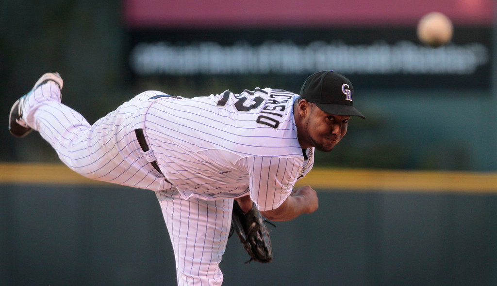. Colorado Rockies starting pitcher Juan Nicasio (12) delivers in the first inning of a baseball game against the New York Mets in Denver, Thursday, May 1, 2014. (AP Photo/Joe Mahoney)