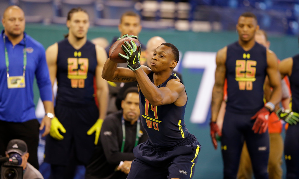 . LSU wide receiver Travin Dural runs a drill at the NFL football scouting combine in Indianapolis, Saturday, March 4, 2017. (AP Photo/Michael Conroy)