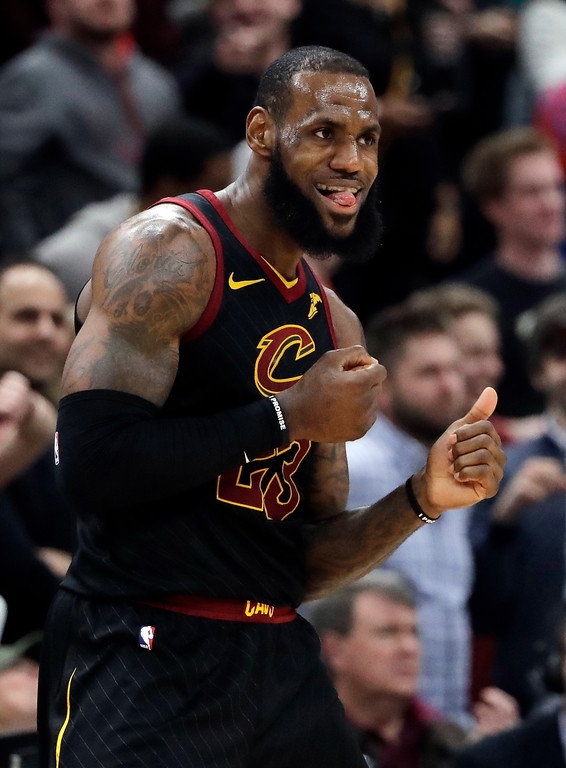 . Cleveland Cavaliers forward LeBron James reacts after scoring a basket against the Chicago Bulls during the second half of an NBA basketball game Saturday, March 17, 2018, in Chicago. The Cavaliers won114-109. (AP Photo/Nam Y. Huh)