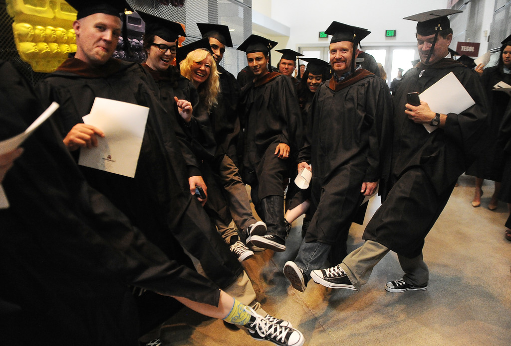 . The Masters of Fine Arts students decorated their black Converse shoes with signatures from the faculty during the summer commencement ceremony at Azusa Pacific University on Friday, July 26, 2013 in Azusa, Calif.  (Keith Birmingham/Pasadena Star-News)
