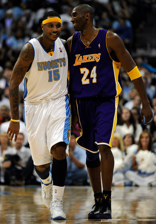 . Kobe Bryant, right, got the best of the Nuggets as he jokes around with Carmelo Anthony during the Nuggets regular-season home opener against L.A. Lakers on Saturday at the Pepsi Center. The Lakers won 104 to 97. RJ Sangosti/ The Denver Post
