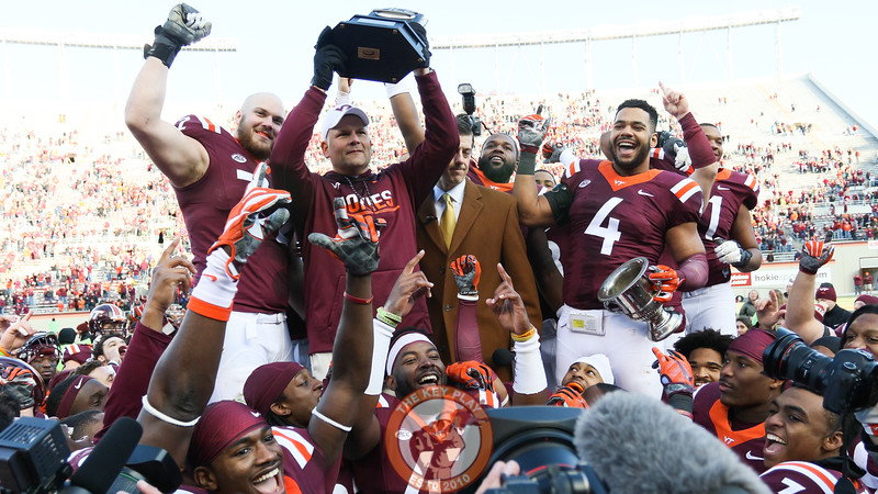 Head coach Justin Fuente holds up the ACC Coastal Division Champion trophy in a ceremony on the field after the game. (Mark Umansky/TheKeyPlay.com)
