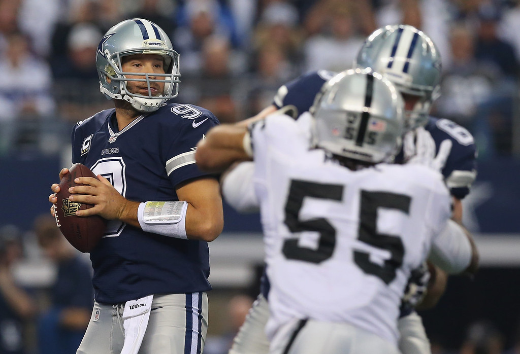 . Tony Romo #9 of the Dallas Cowboys throws the ball against the Oakland Raiders at AT&T Stadium on November 28, 2013 in Arlington, Texas.  (Photo by Ronald Martinez/Getty Images)