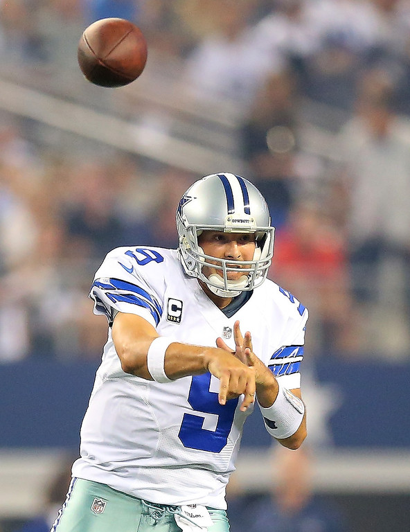 . Quarterback Tony Romo #9 of the Dallas Cowboys passes the ball in the first quarter against the New York Giants on September 8, 2013 at AT&T Stadium in Arlington, Texas.  (Photo by Ronald Martinez/Getty Images)