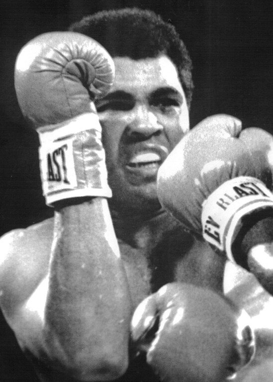 . LAS VEGAS: Muhammad Ali tries to cover up under a barrage of blows by Larry Holmes. Holmes retained his heavyweight crown 10/2. 1980. Credit: UPI