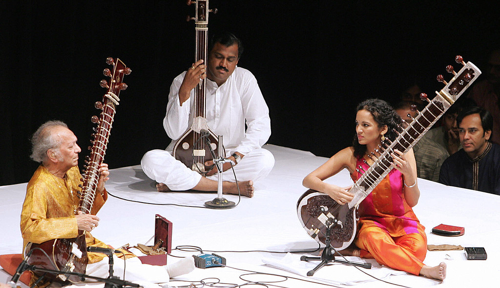 . Mumbai, INDIA:  Indian sitar maestro Pandit Ravi Shankar (L) and his daughter Anoushka (R) at a live performance in Mumbai, 11 February 2006.  Ravi Shankar performed together with tabla exponent Ustad Zakir Hussain and Anoushka.   AFP PHOTO/Indranil MUKHERJEE  (Photo credit should read INDRANIL MUKHERJEE/AFP/Getty Images)