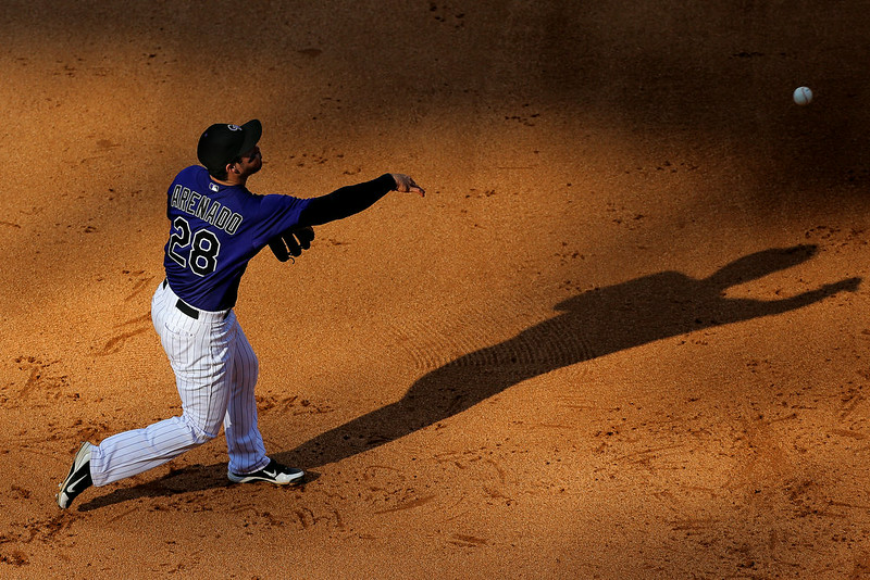 . Nolan Arenado #28 of the Colorado Rockies makes a throw to first base for the first out of the fifth inning against the San Francisco Giants at Coors Field on September 1, 2014 in Denver, Colorado. The Rockies defeated the Giants 10-9 on a walk-off single by Charlie Blackmon. (Photo by Justin Edmonds/Getty Images)