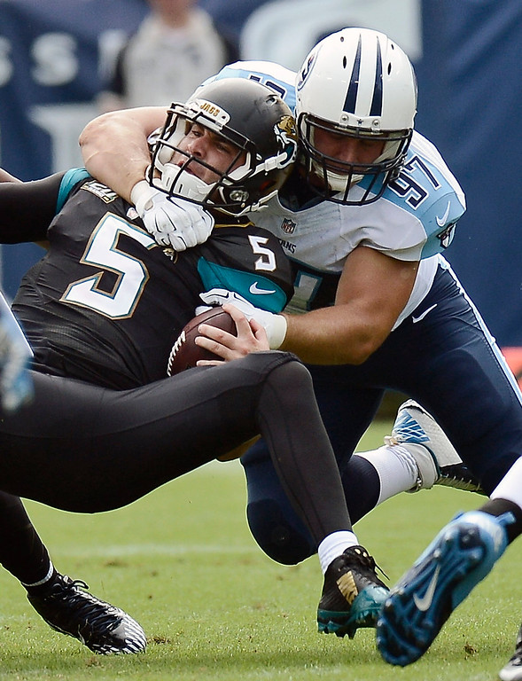 . Jacksonville Jaguars quarterback Blake Bortles (5) is sacked by Tennessee Titans defensive end Karl Klug (97) for an 8-yard loss in the second quarter of an NFL football game Sunday, Oct. 12, 2014, in Nashville, Tenn. (AP Photo/Mark Zaleski)
