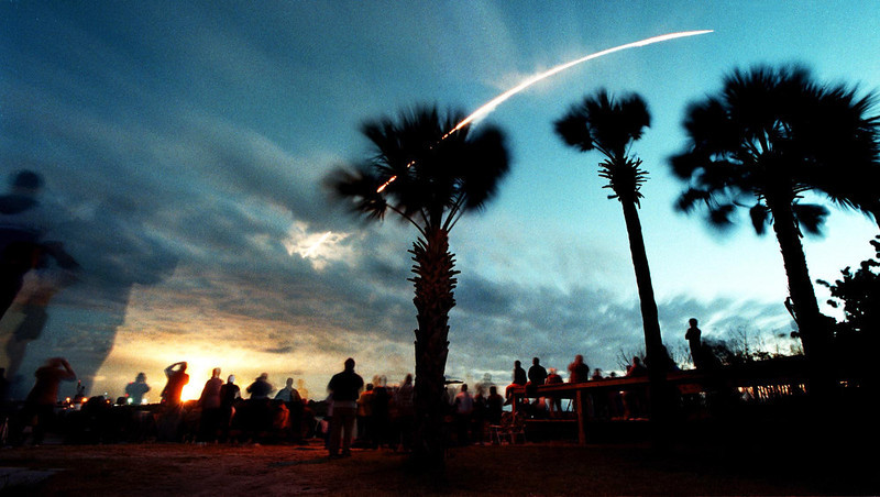 . Crowds gather at Jetty Park in Cape Canaveral, Fla., Friday morning, March 1, 2002,  to watch as the space shuttle Columbia streaks across the sky after liftoff with a seven member crew that will overhaul the Hubble Space Telescope during the 11-day  mission (AP Photo/Florida Today, Craig Rubadoux)