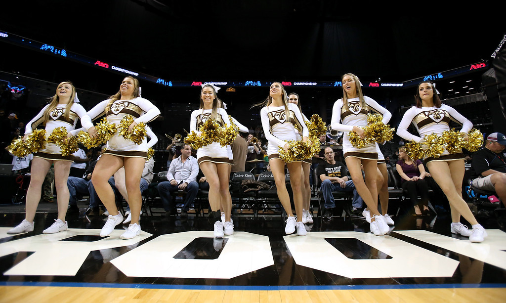 . The St. Bonaventure Bonnies cheerleaders perform in the game against the Saint Joseph\'s Hawks during the Semifinals of the 2014 Atlantic 10 Men\'s Basketball Tournament  at Barclays Center on March 15, 2014 in the Brooklyn borough of New York City.  (Photo by Mike Lawrie/Getty Images)