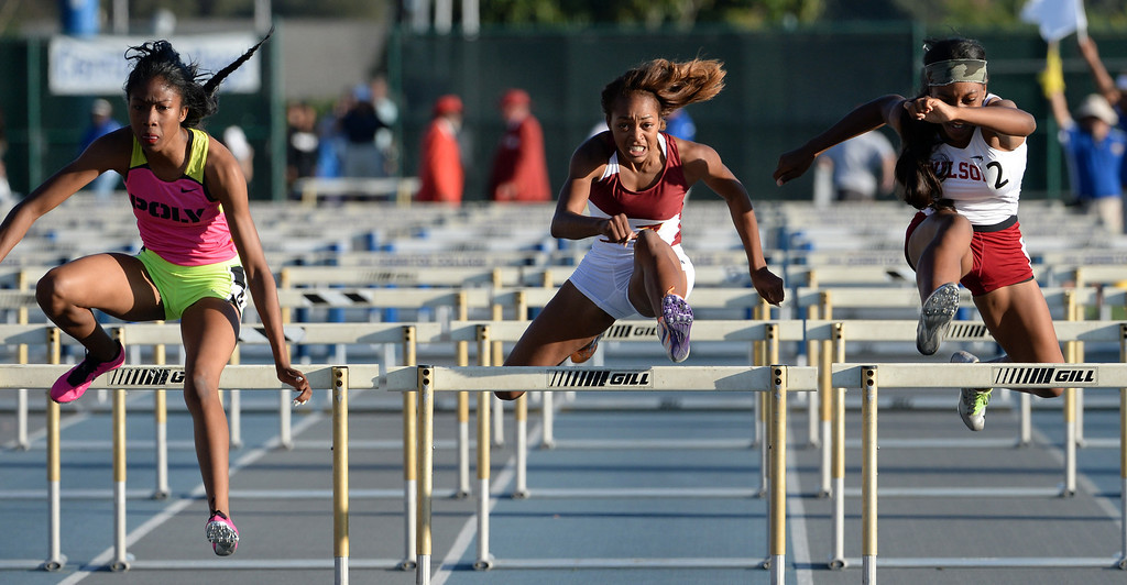 . Alemany\'s Skylin Harbin, center along with Pasadena Poly\'s Ebony Crear,left, and Long beach Wilson\'s Elijah McDonald competes in the 100 meter hurdles during the CIF-SS Masters Track and Field meet at Falcon Field on the campus of Cerritos College in Norwalk, Calif., on Friday, May 30, 2014.   (Keith Birmingham/Pasadena Star-News)