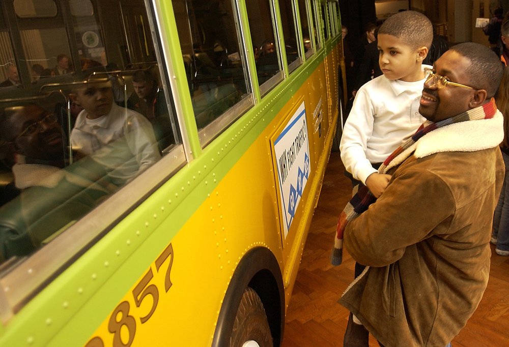 . Keith Davis, right, and his son, Keith Jr., examine the bus in which Rosa Parks refused to give up her seat in 1955 on Friday, Jan. 31, 2003, at the museum in Dearborn, Mich. The bus was unveiled for 300 museum members Friday and will be shown to the public starting Saturday, Feb. 1, the first day of Black History Month. The museum purchased the bus in October 2001 for $492,000 after it was found in a field in Alabama. (AP Photo/John F. Martin)