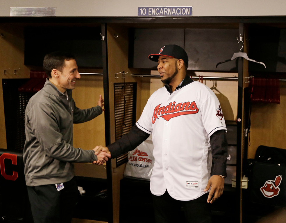 . Cleveland Indians\' Edwin Encarnacion shakes hands with Cleveland Indians president of baseball operations Chris Antonetti, Thursday, Jan. 5, 2017, in Cleveland. One win from a World Series title last season, the Cleveland Indians finalized a $65 million, three-year contract with free agent slugger Encarnacion. (AP Photo/Tony Dejak)